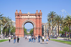 Arc de Triomf in Barcelona. BARCELONA, SPAIN - APRIL 12: Tourists walking at Passeig de Lluis Companys in April 12, 2011 in Barcelona, Spain Royalty Free Stock Images
