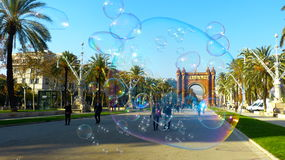 The Arc de Triomf Barcelona in Bubbles. The Arc de Triomf in Barcelona captured from behind a cloud of bubbles Royalty Free Stock Photo