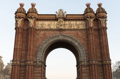 Arc de Triomf, Barcelona. Low angle view of the Arc de Triomf at dusk, a triumphal arch in Barcelona. It was built as the main access gate for the 1888 Barcelona Stock Images