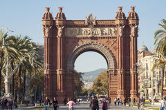 Arc de Triomf, Barcelona. BARCELONA - NOVEMBER 16, 2009 :many people take walk under historic Arc de Triomf building by sunny autumn day on November 16, 2009 in Stock Photos