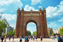 Arc de Triomf in Barcelona. BARCELONA, SPAIN - APRIL 9, 2017: People walking near  Arc de Triomf in Barcelona during a spring day Stock Photos