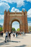 Arc de Triomf in Barcelona. BARCELONA, SPAIN - APRIL 9, 2017: People walking near  Arc de Triomf in Barcelona during a spring day Stock Photography