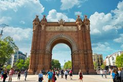 Arc de Triomf in Barcelona. BARCELONA, SPAIN - APRIL 9, 2017: People walking near  Arc de Triomf in Barcelona during a spring day Royalty Free Stock Photography
