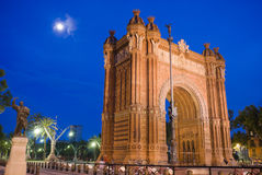 Arc de Triomf , Barcelona, Spain. Moonlight and Arc de Triomf the grand entrance to Parc de la Ciutadella in Barcelona. Statue (left) and Arch both designed and Royalty Free Stock Images