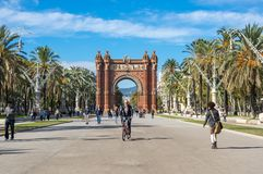 The Arc de Triomf. BARCELONA, SPAIN - OCTOBER 22, 2015: The Arc de Triomf  is a triumphal arch in the city of Barcelona in Catalonia, Spain. The arch is built in Stock Image