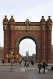 Arc de Triomf. Barcelona. Spain. Arc de Triomf or Triumphal Arch in Barcelona. Catalonia. Spain. With people walking around Stock Photo