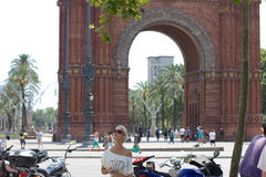 Arc de Triomf with Blond Girl in sunglasses Tourist. Arc de Triomf with Blond Stock Photo