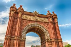 Arc de Triomf, iconic triumphal arc in Barcelona, Catalonia, Spa. Arc de Triomf, iconic triumphal arc and landmark in Barcelona, Catalonia, Spain Royalty Free Stock Photography