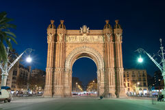 The 'Arc De Triomf' By Night In Barcelona, Spain. Night view of the Arc de Triomf that is built in reddish brickwork in the Neo-Mud�jar style for the Exposici Stock Images