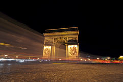 Arc de Triompe, Paris. Arc de triomphe at night, Paris, France with light trails Royalty Free Stock Images