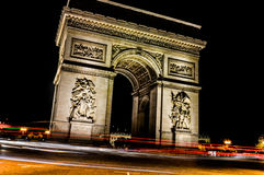 Arc De Triompe. This is a shot of the Arc De Triompe in Paris, France with traffic passing at night using long exposure photography Royalty Free Stock Photo