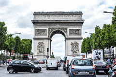 Arc de Triomph. The historic monument during an afternoon traffic Royalty Free Stock Images
