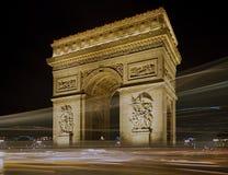 Arc de Triomphe στο Παρίσι τη νύχτα Στοκ Εικόνες