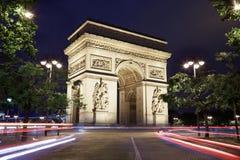 Arc de Triomphe στο Παρίσι τη νύχτα Στοκ Εικόνα