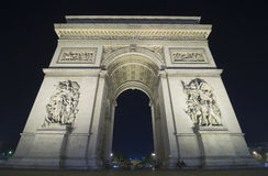 The Arc de Triomphe. Arc de Triomphe in Paris, France shot with a long exposure with a tourist bus in the background Stock Photography