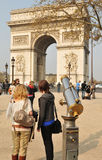 Arc de Triomphe. Tourists admiring the Arc de Triomphe in Paris, France Stock Photos