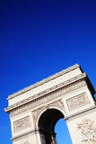 Arc De Triomphe. The  Arc De Triomphe in Paris France, a French national landmark with a clear blue sky Stock Photo
