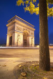 Arc de Triomphe. (arch of triumph) in Paris at dusk Royalty Free Stock Images