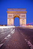 Arc de Triomphe. Front view of Arc de Triomphe (Arch of Triumph) in Paris at dusk - vertical shot Stock Photos