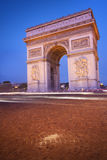 Arc de Triomphe. Paris, France - Arc de Triomphe (Arch of Triumph) at dusk Stock Photography