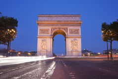 Arc de Triomphe. Front view of Arc de Triomphe (Arch of Triumph) in Paris at dusk with traffic light trail Stock Images