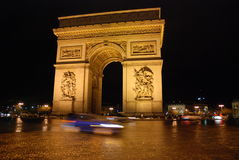 Arc de Triomphe. At night with motion blur Stock Photography