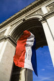 Arc de Triomphe. French flag on the Arc of Triumph Royalty Free Stock Image