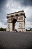 Arc de Triomphe (Arch of Triumph). On gloomy sky background Royalty Free Stock Photo