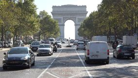 Arc de Triomphe, Arch of Triumph, car passing, trees alley. UHD 4K stock footage