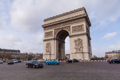 Arc de Triomphe, Arch of Triumph, Famous Tourism Landmark in Paris France. Cars in front of Arc de Triomphe, Arch of Triumph, Famous Tourism Landmark in Paris Royalty Free Stock Photos