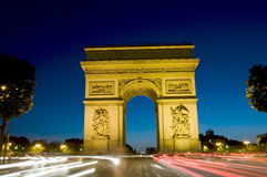 Arc de triomphe arch of triumph paris france. The arc de triomph on the champs elysee in paris france at night with motion blur Stock Photo