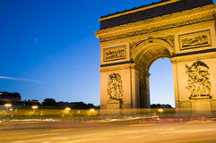 Arc de triomphe arch of triumph paris france. The arc de triomphe (arch of triumph) at night with car streaks in the center of the Place Charles de Gaulle also Royalty Free Stock Photo