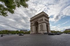 Arc de Triomphe - Arch of Triumph, Paris, France. The Arc de Triomphe de l`Étoile Triumphal Arch of the Star is one of the most famous monuments in Paris Stock Photography