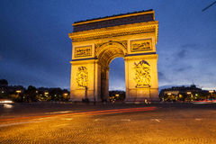 Arc de triomphe arch of triumph paris france. The arc de triomphe (arch of triumph) at night with car streaks in the center of the Place Charles de Gaulle in Stock Photography