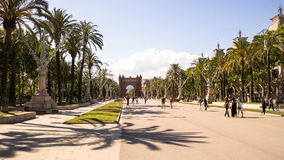 Arc de Triomphe Barcelona. Barcelona`s boulevard with palms and Arc de Triomphe Royalty Free Stock Image