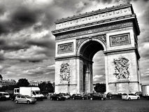 Arc de Triomphe. Black and white photo of the Arc de Triomphe with traffic Royalty Free Stock Image