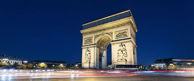 Arc de Triomphe and car lights. Panoramic view of Arc de Triomphe by night xith car lights Royalty Free Stock Photos
