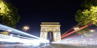 Arc de Triomphe and car lights at night. Night time in Arc de Triomphe, car lights, long exposure Royalty Free Stock Photography