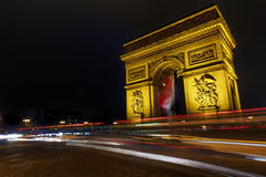 Arc de Triomphe. Car traffic around the Arch of Triumph at Night, Paris, France Royalty Free Stock Image