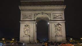 Arc de Triomphe and car traffic in night Paris, France stock footage