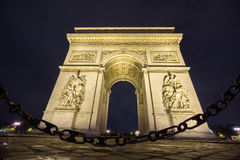 Arc de Triomphe and chain at night. Night time in Arc de Triomphe with chain reflection Stock Photography