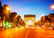 Arc de triomphe, Paris, France. Arc de Triomphe and Champ Elysees at night, Paris, France, retro toned Stock Photos