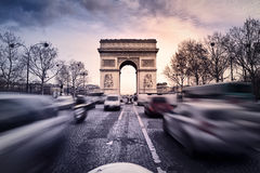 Arc de Triomphe on the Champs Elysées. Arc de Triomphe in Paris, France. Heavy trafic on the Champs Elysees Royalty Free Stock Photo
