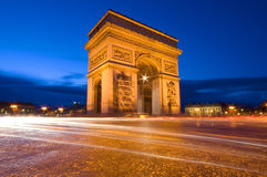 Arc de Triomphe and Champs-Elysees Avenue. At night, in Paris Stock Photo