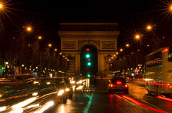 Arc de Triomphe and Champs-Elysees Avenue. At night, in Paris Stock Photos