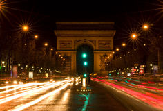 Arc de Triomphe and Champs-Elysees Avenue. At night, in Paris Stock Image