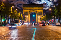 The Arc de Triomphe. Arc de Triomphe and Champs-Elysees Avenue at night in Paris, France Royalty Free Stock Photo