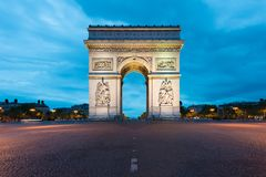 Arc de Triomphe and Champs Elysees, Landmarks in center of Paris. At night. Paris, France royalty free stock images