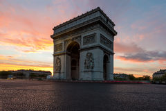 Arc de Triomphe and Champs Elysees, Landmarks in center of Paris. At sunset. Paris, France royalty free stock image