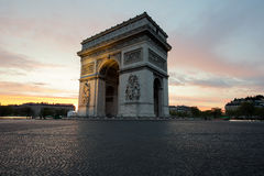 Arc de Triomphe and Champs Elysees, Landmarks in center of Paris. At sunset. Paris, France royalty free stock images